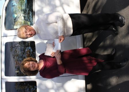 Executive Directors Exchange Check and Title for New Trinity Center Van